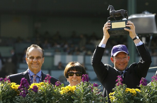 Owner of 'Pounced'  Lady Serena Rothschild poses with her son Nat Rothschild and Los Angeles Dodgers baseball manager Joe Torre at Santa Anita Park in Arcadia